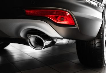 car exhaust pipe. Exhaust pipe of a luxury car. details of stylish car interior, leather interior. Close up
